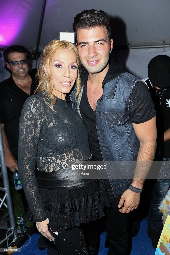 <a gi-track='captionPersonalityLinkClicked' href=/galleries/search?phrase=Ivy+Queen&family=editorial&specificpeople=212826 ng-click='$event.stopPropagation()'>Ivy Queen</a> and JenCarlos Canela backstage at the Zolazo concert at Bayfront Park Amphitheater on September 15, 2013 in Miami, Florida.