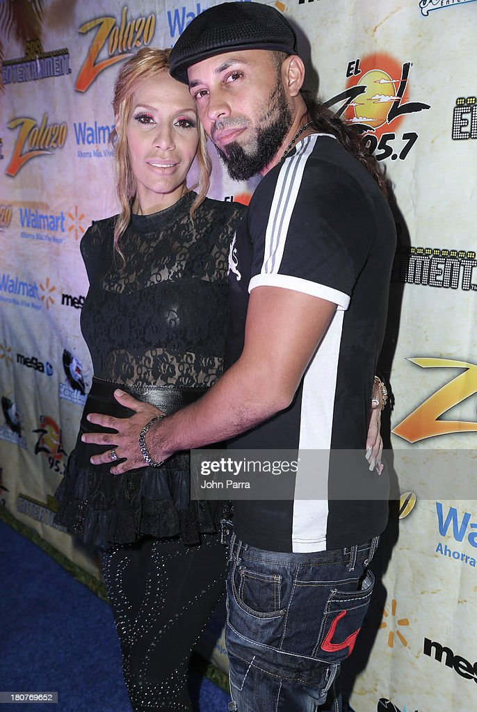 <a gi-track='captionPersonalityLinkClicked' href=/galleries/search?phrase=Ivy+Queen&family=editorial&specificpeople=212826 ng-click='$event.stopPropagation()'>Ivy Queen</a> and Xavier Sanchez backstage at the Zolazo concert at Bayfront Park Amphitheater on September 15, 2013 in Miami, Florida.