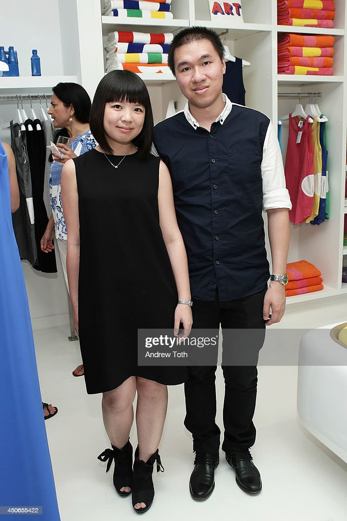 Ivy Tam (L) and Levi Li attend Hamptons Magazine celebrates The New Lisa Perry store on June 14, 2014 in East Hampton, New York.
