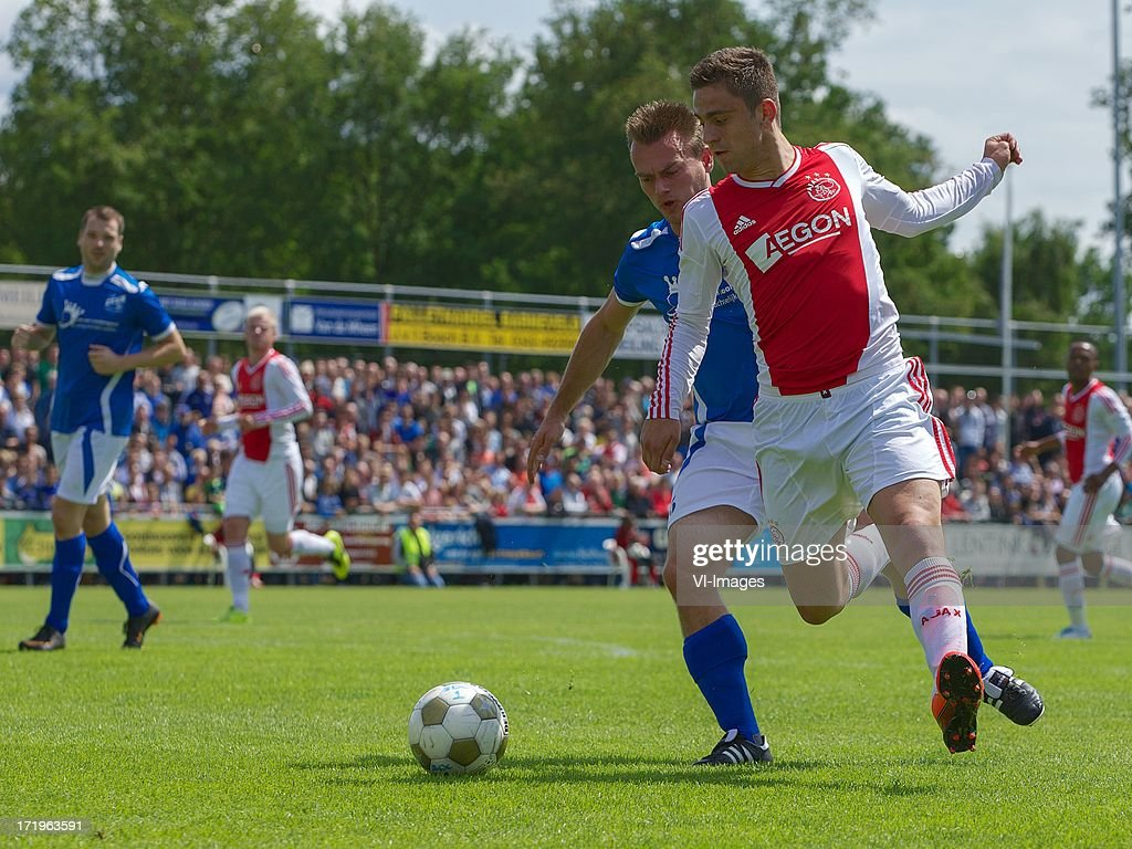 Iwan Bos of SDC Putten, Dejan Meleg of Ajax during the pre season friendly match between SDC Putten and Ajax on June 29, 2013 in Putten, The Netherlands.