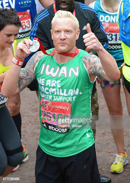 Iwan Thomas poses at the finish line during The London Marathon 2015 on April 26 2015 in London England