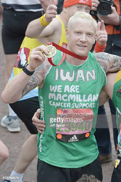 Iwan Thomas poses with his medal after completing the Virgin Money London Marathon on April 24 2016 in London England