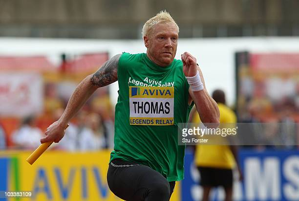 Iwan Thomas takes the baton in the Aviva legends relay race during the Aviva London Grand Prix at Crystal Palace on August 14 2010 in London England