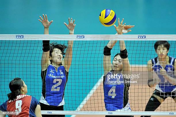 Iwasaka Nana and Kotoh Chizura of Hisamitsu block Do Thi Minh of Thon Tin Lienvietpostbanl spikes during the FIVB 17th Princess Cup Asian Women's Cup...