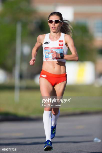 Iwona Bernadelli of Poland running to sixth place with a time of 23447 in the Ottawa Marathon road race during the Tamarack Ottawa Race Weekend The...