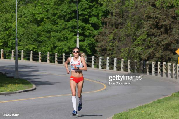 Iwona Bernardelli of Poland running to sixth place in the Ottawa Marathon road race during the Tamarack Ottawa Race Weekend The Ottawa Marathon is...