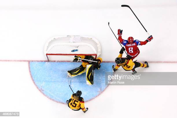 Iya Gavrilova of Russia celebrates after scoring a goal in the third period against Viona Harrer of Germany during the Women's Ice Hockey Preliminary...