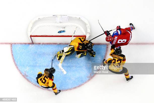 Iya Gavrilova of Russia scores a goal in the third period against Viona Harrer of Germany during the Women's Ice Hockey Preliminary Round Group B...