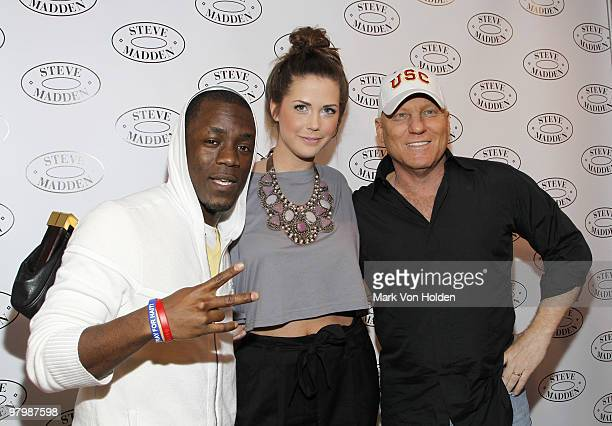 Iyaz Erin Lucas and designer Steven Madden pose at a live concert by Iyaz at Steven by Steve Madden on March 23 2010 in New York City