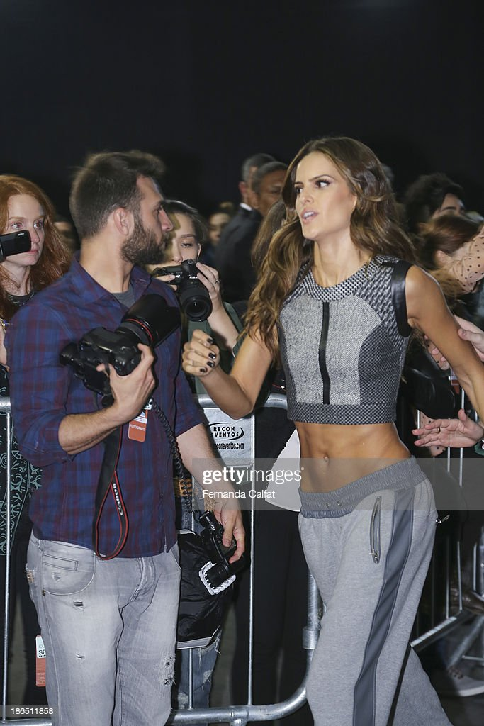 Izabel Goulart atends at backstage a the Colcci show at Sao Paulo Fashion Week Winter 2014 on October 31, 2013 in Sao Paulo, Brazil.