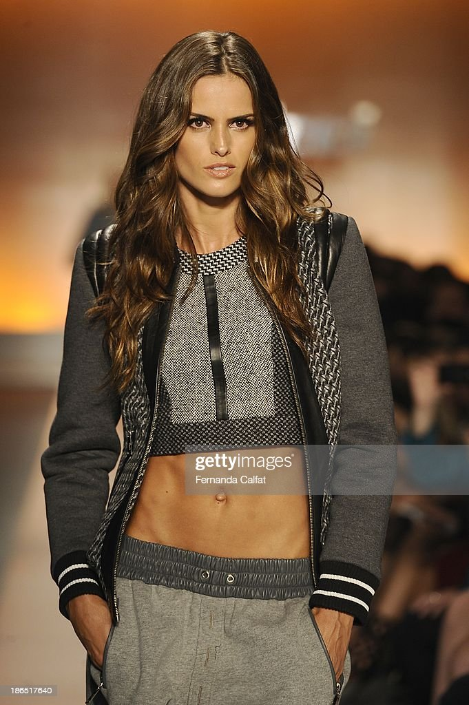 <a gi-track='captionPersonalityLinkClicked' href=/galleries/search?phrase=Izabel+Goulart&family=editorial&specificpeople=566749 ng-click='$event.stopPropagation()'>Izabel Goulart</a> walks the runway during Colcci show at Sao Paulo Fashion Week Winter 2014 on October 31, 2013 in Sao Paulo, Brazil.
