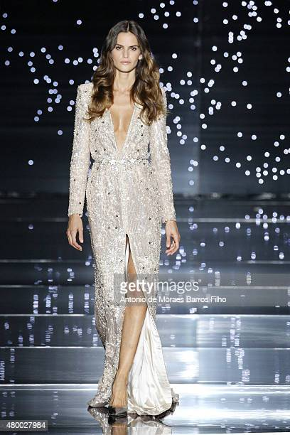 Izabel Goulart walks the runway during the Zuhair Murad show as part of Paris Fashion Week Haute Couture Fall/Winter 2015/2016 on July 9 2015 in...