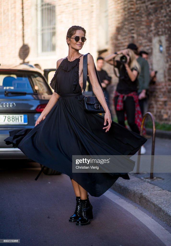 Izabel Goulart wearing a black dress is seen outside Alberta Ferretti during Milan Fashion Week Spring/Summer 2018 on September 20, 2017 in Milan, Italy.