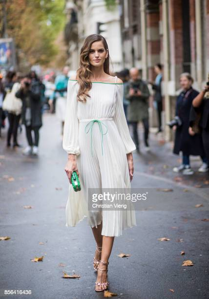 Izabel Goulart wearing a white dress seen outside Valentino during Paris Fashion Week Spring/Summer 2018 on October 1 2017 in Paris France
