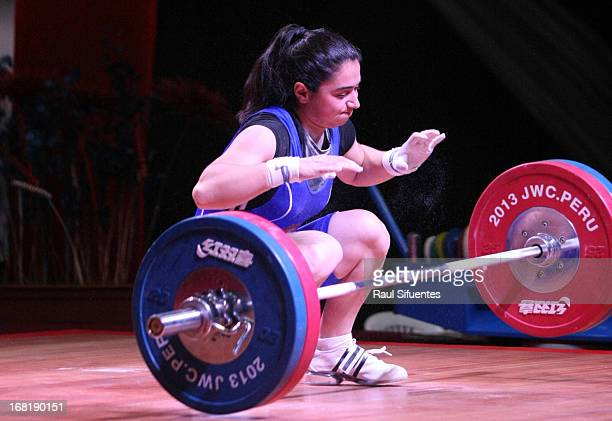 Izabella Yaylyan of Armenia competes in the Women's 58kg Clean and Jerk during day three of the 2013 Junior Weightlifting World Championship at Maria...