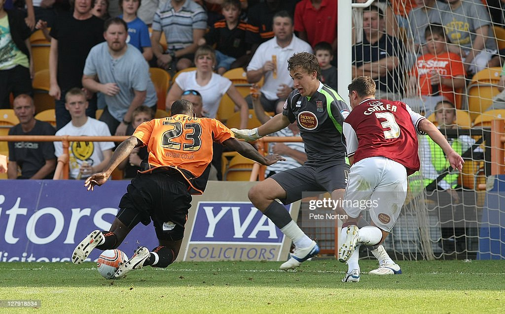 Izale McLeod of Barnet stumbles as he attempts an effort on goal watched by Sam Walker and Ashley Corker of Northampton Town during the npower League Two match between Barnet and Northampton Town at Underhill Stadium on October 1, 2011 in Barnet, England.
