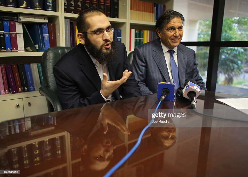 Izhar Khan (L), imam of a Margate, Florida mosque, and his lawyer, Joseph Rosenbaum, hold a press conference to discuss a federal judge's decision to throw out the terrorism charges against him on January 17, 2013 in Miami, Florida. Izhar Khan and his father, a Miami imam, who were arrested in May 2011, stood accused of providing financial support to the Pakistani Taliban terrorist organization.