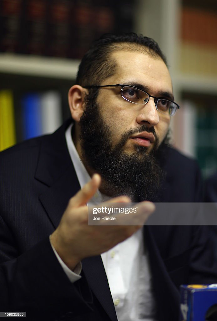 Izhar Khan, imam of a Margate, Florida mosque, speaks during a press conference to discuss a federal judge's decision to throw out the terrorism charges against him on January 17, 2013 in Miami, Florida. Izhar Khan and his father, a Miami imam, who were arrested in May 2011, stood accused of providing financial support to the Pakistani Taliban terrorist organization.