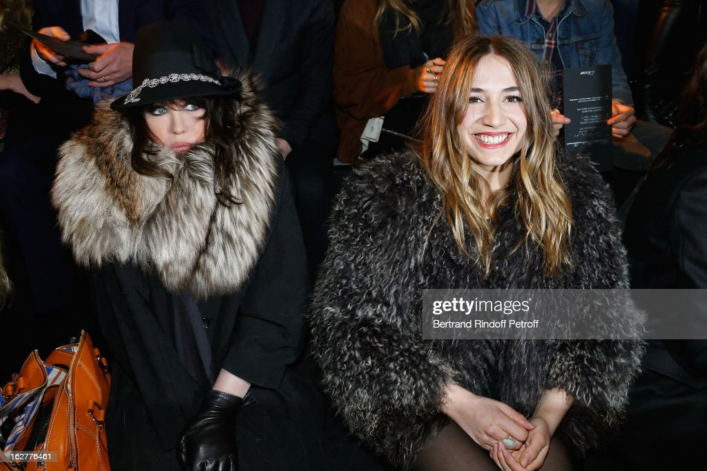 Izia Higelin (R) and Isabelle Adjani attend the Etam Live Show Lingerie at Bourse du Commerce on February 26, 2013 in Paris, France.