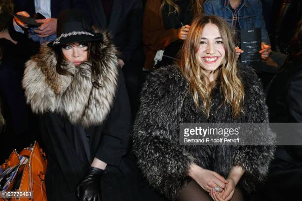 Izia Higelin and Isabelle Adjani attend the Etam Live Show Lingerie at Bourse du Commerce on February 26 2013 in Paris France