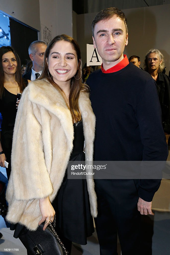 Izia Higelin and <a gi-track='captionPersonalityLinkClicked' href=/galleries/search?phrase=Raf+Simons+-+Fashion+Designer&family=editorial&specificpeople=7070305 ng-click='$event.stopPropagation()'>Raf Simons</a> attend the Christian Dior Fall/Winter 2013 Ready-to-Wear show as part of Paris Fashion Week on March 1, 2013 in Paris, France.