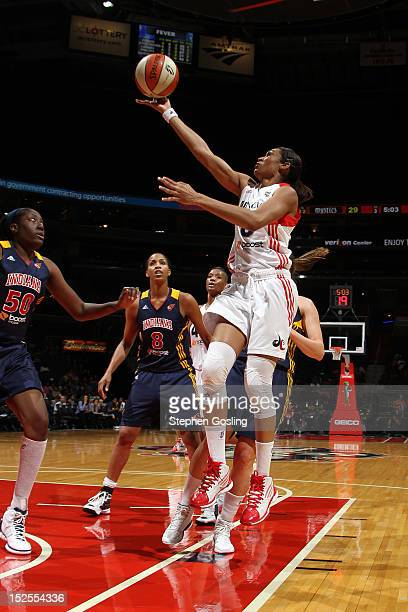 Iziana Castro Marques of the Washington Mystics shoots against Jessica Davenport of the Indiana Fever at the Verizon Center on September 21 2012 in...