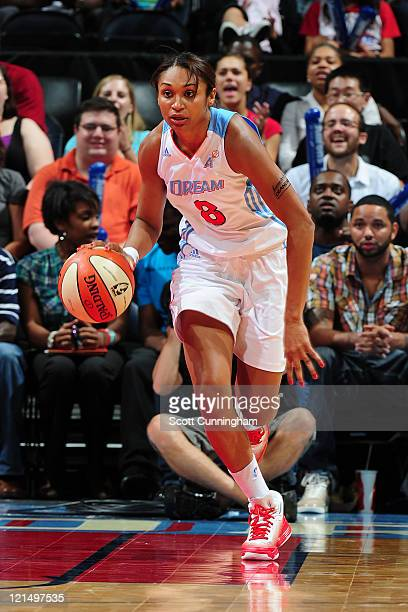 Iziane Castro Marques of the Atlanta Dream drives against the Connecticut Sun at Philips Arena on August 19 2011 in Atlanta Georgia NOTE TO USER User...