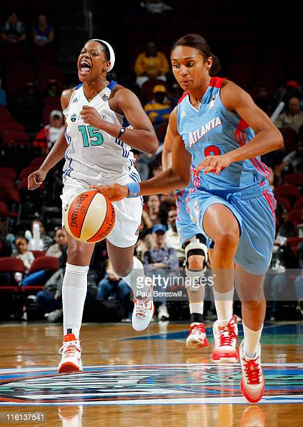 Iziane Castro Marques of the Atlanta Dream drives upcourt as Kia Vaughn of the New York Liberty follows in the second half on June 14 2011 at the...