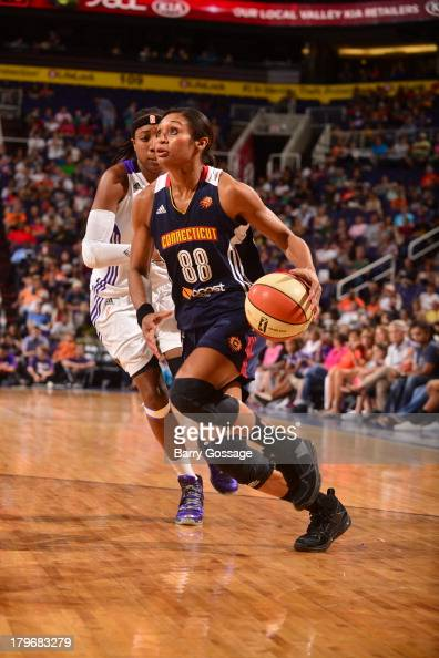 Iziane Castro Marques of the Connecticut Sun drives against Alexis Hornbuckle of the Phoenix Mercury on August 31 2013 at US Airways Center in...