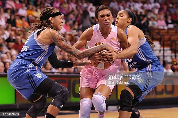 Iziane Castro Marques of the Connecticut Sun fights for the ball against the Minnesota Lynx on August 22 2013 at the Mohegan Sun in Uncasville...