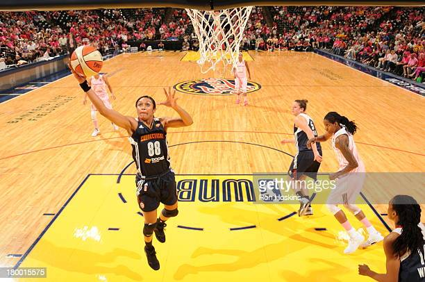 Iziane Castro Marques #of the Connecticut Sun lays the ball up against the Indiana Fever on September 7 2013 at Bankers Life Fieldhouse in...