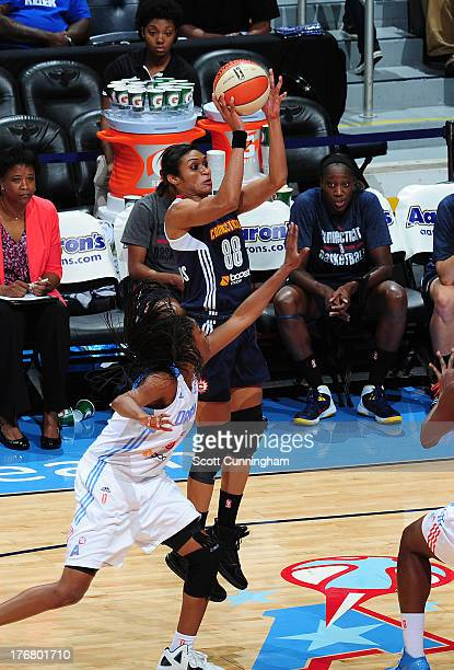 Iziane Castro Marques of the Connecticut Sun puts up a shot against the Atlanta Dream at Philips Arena on August 16 2013 in Atlanta Georgia NOTE TO...