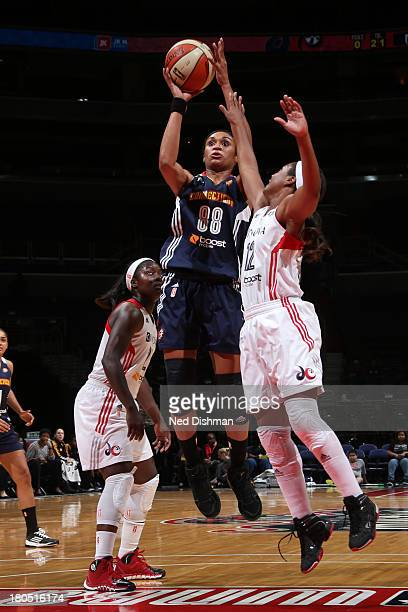 Iziane Castro Marques of the Connecticut Sun shoots against Ivory Latta of the Washington Mystics at the Verizon Center on September 13 2013 in...