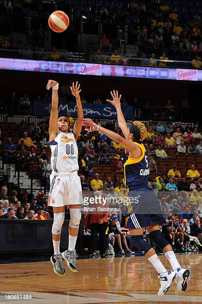 Iziane Castro Marques of the Connecticut Sun shoots against Layshia Clarendon of the Indiana Fever on September 15 2013 at the Mohegan Sun in...