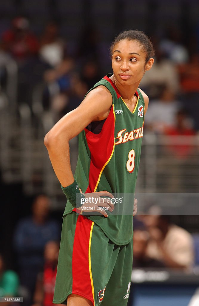 Iziane Castro Marques #8 of the Seattle Storm looks on during a game against the Washington Mystics at MCI Center on July 23, 2006 in Washington, D.C. The Storm won 73-71.