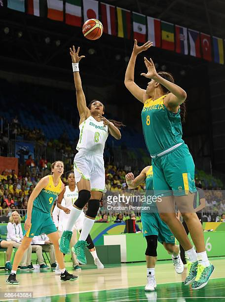 Iziane Marques of Brazil attempts a shot over Elizabeth Cambage of Australia during a Women's Basketball Preliminary Round game on Day 1 of the Rio...