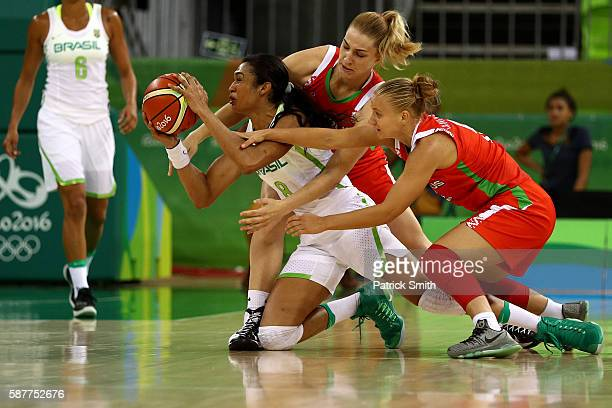 Iziane Marques of Brazil looks to pass as she is pressured by Maryia Papova and Aliaksandra Tarasava of Belarus in the Women's Basketball Preliminary...