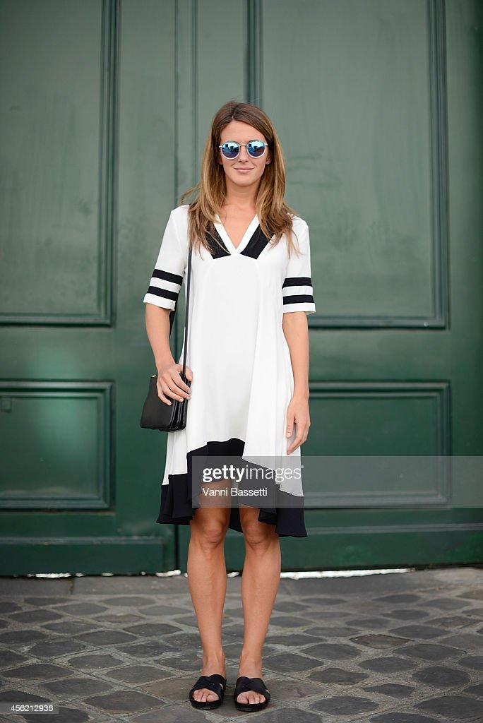 Izortze Setien poses wearing an H and M dress Celine bag and Vagabond sandals on September 27 2014 in Paris France