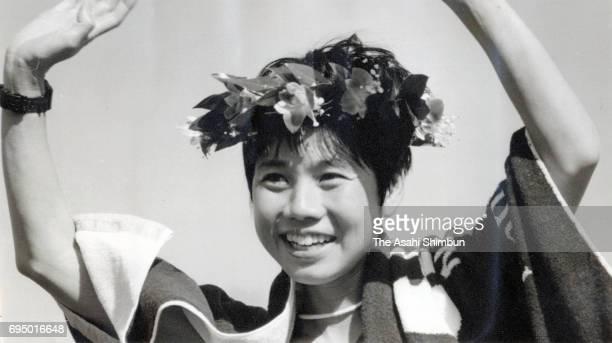 Izumi Maki of Japan celebrates on the podium after winning the 17th Nagoya International Women's Marathon at Mizuho Athletic Stadium on March 10 1996...