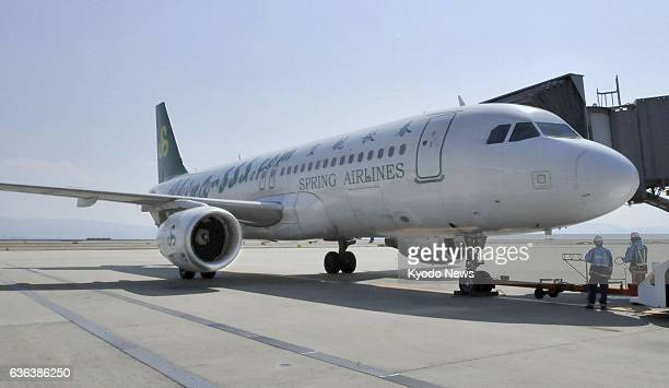 Izumisano Japan A passenger plane operated by Chinese budget carrier Spring Airlines Co is seen on the tarmac at Kansai International Airport near...