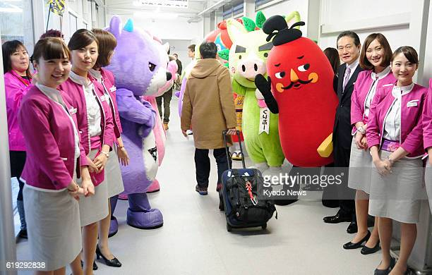 Izumisano Japan Cabin attendants of Peach Aviation Ltd and lifesize mascots from various locations served by the airline welcome departing passengers...