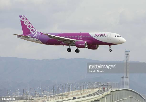 Izumisano Japan File photo taken in February 2012 shows a Peach Aviation Ltd aircraft over Kansai International Airport near Osaka Peach is facing...