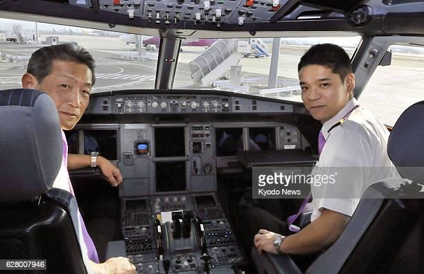 Izumisano Japan Photo taken in January 2014 at Kansai International Airport shows Ryoji Fujii a rookie pilot of Peach Aviation ready to fly an...