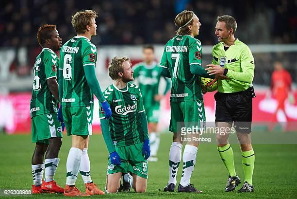 Izunna Uzochukwu Jeppe Tverskov Rasmus Jonsson and Joan Simun Edmundsson of OB Odense shows frustration against Referee Jakob Kehlet during the...