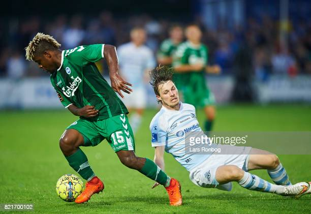 Izunna Uzochukwu of OB Odense and Nicolas Mortensen of FC Helsingor compete for the ball during the Danish Alka Superliga match between FC Helsingor...