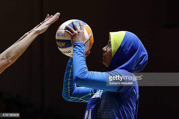 Izyan Syazana Mohd Wazir of Malaysia takes aim at goal during the women's netball gold medal match between Singapore and Malaysia at the OCBC Arena...