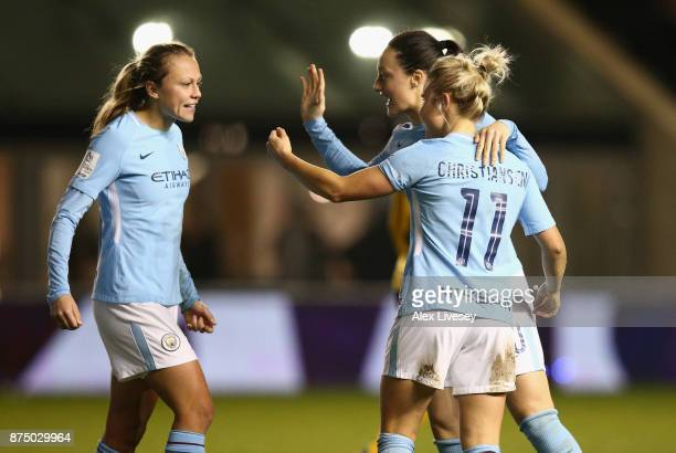 Izzy Christiansen of Manchester City Women celebrates with Claire Emslie and Megan Campbell after scoring her goal during the UEFA Women's Champions...