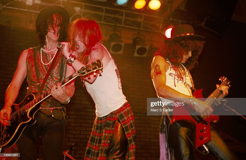 Izzy Stradlin, Axl Rose and Slash of the rock band 'Guns n' Roses' perform onstage at the Troubadour with the 'Appettite for Destruction' lineup together for the first time on June 6, 1985 in Los Angeles, California.