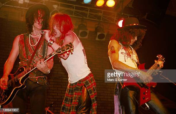 Izzy Stradlin Axl Rose and Slash of the rock band 'Guns n' Roses' perform onstage at the Troubadour with the 'Appettite for Destruction' lineup...