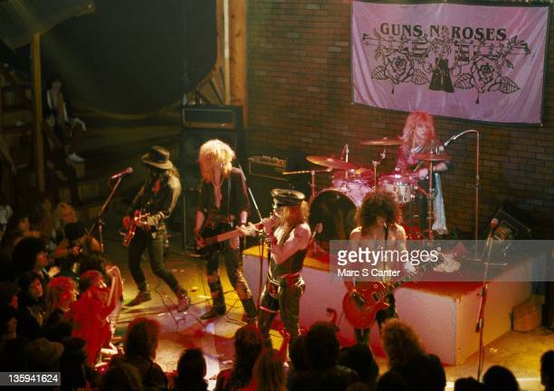 Izzy Stradlin Duff McKagan Axl Rose Slash and Steven Adler of the rock band 'Guns n' Roses' perform onstage at the Troubadour where they played 'My...